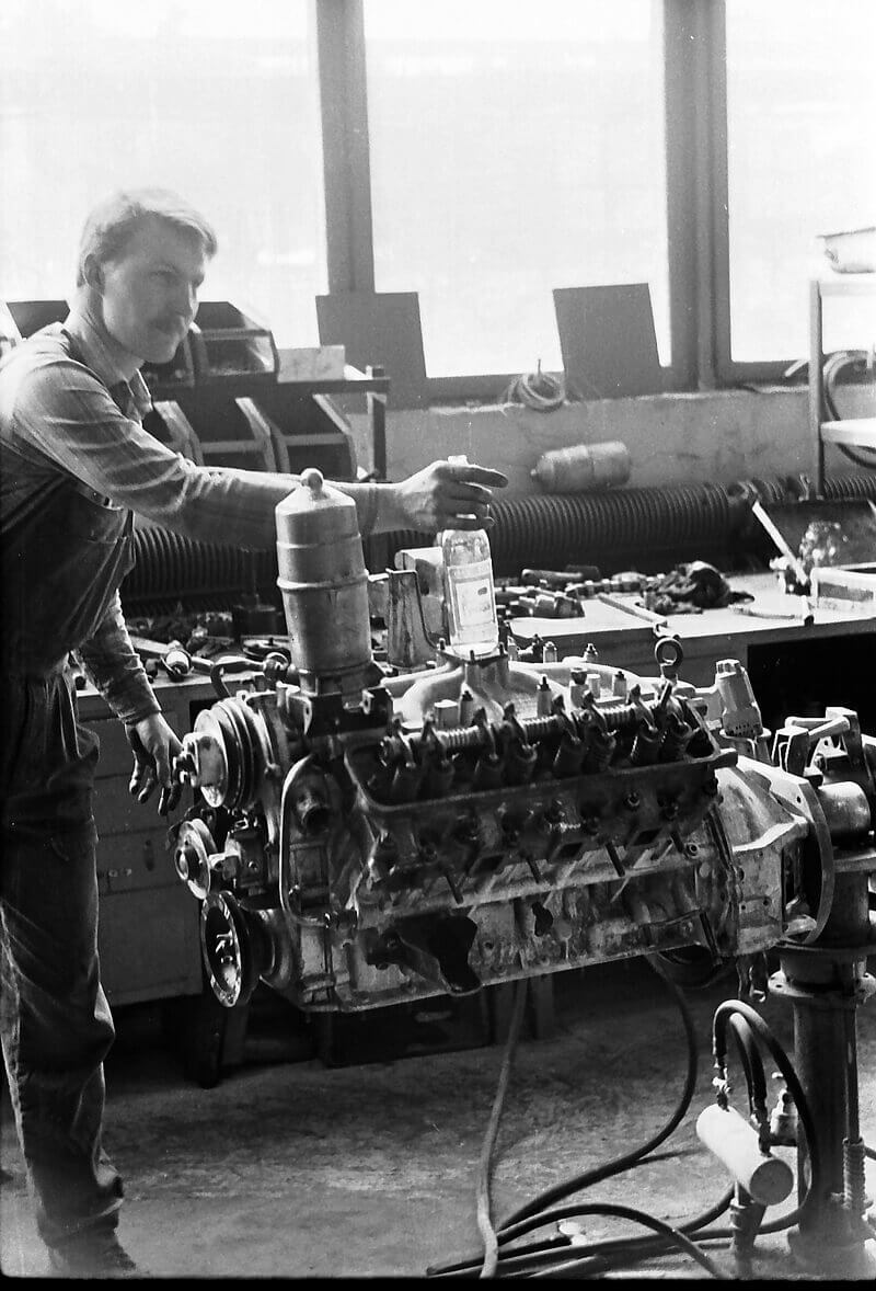 a historic picture of a man working on an engine in Kuusalu Factory